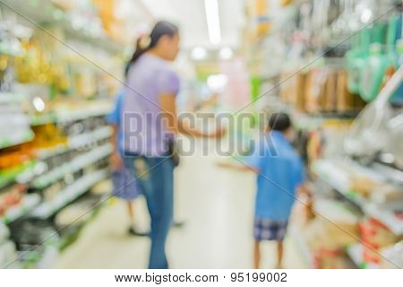 Blurred Image Of Shopping Mall And People For Background Usage