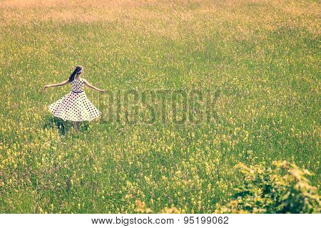 Woman With A Cute Vintage Outfit Is Dancing On The Meadow