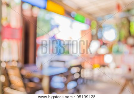 Blur Image Of Coffee Shop With Bokeh On Day Time For Background Usage.