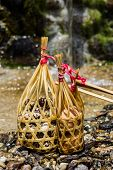 picture of quail  - all quail eggs in round bamboo basket boil on hot spring - JPG
