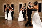 stock photo of ballroom dancing  - a bride and groom opening the dance floor - JPG