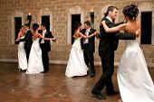 picture of ballroom dancing  - a bride and groom opening the dance floor - JPG