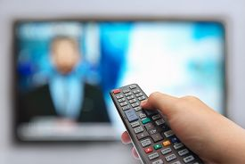 stock photo of hand god  - man hand switches TV channels - JPG