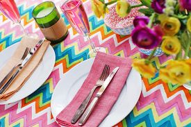 picture of chevron  - Bright colorful table setting with multi colored chevron pattern tablecoth - JPG