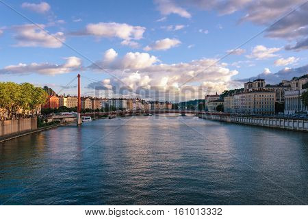 Lyon scenic view on river Saone with Passerelle Saint-Vincent and the Cathedral at sunset