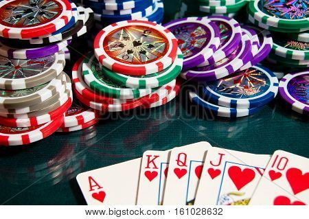 Royal Flash Win In Poker And Big Heap Of Poker Chips