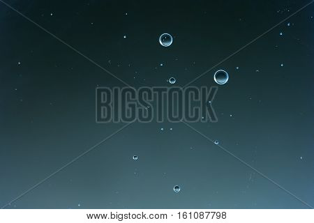 Macro Oxygen bubbles in water on a blue background, concept such as ecology and other your successful projects