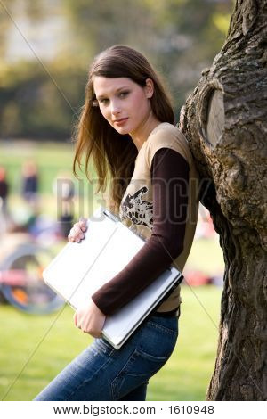 Leaning Against A Tree With Notebook
