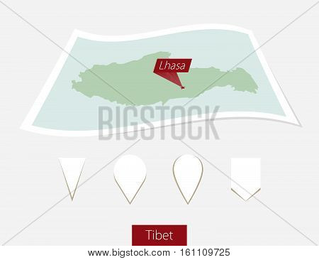 Curved Paper Map Of Tibet With Capital Lhasa On Gray Background. Four Different Map Pin Set.