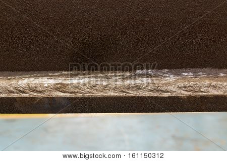 The close up Welding on steel Grinding a welded
