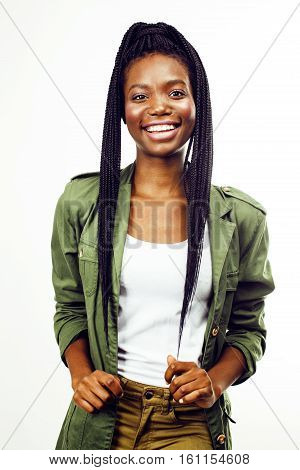 young pretty african-american girl posing cheerful emotional on white background isolated, lifestyle people concept close up