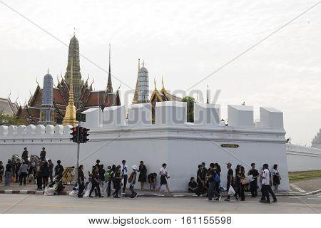 BANGKOK THAILAND - NOV 5 : people on corner of wat phra kaew at Ratchadamnoen Nai road in sanam luang area while the funeral of king Bhumibol Adulyadej in Grand Palace on november 5 2016