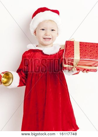 little girl as Santa Claus with a bell and Christmas present