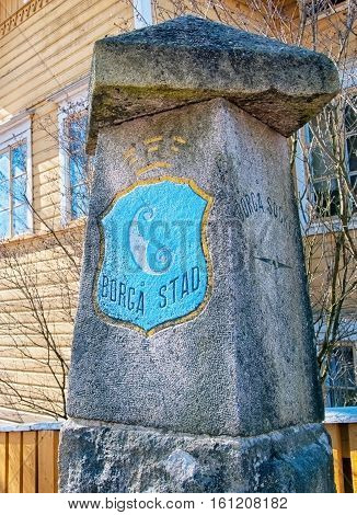 PORVOO, FINLAND - APRIL 15, 2010: Stone pillar with coat of arms of the Porvoo on Krkkokatu Street in historical part of the town