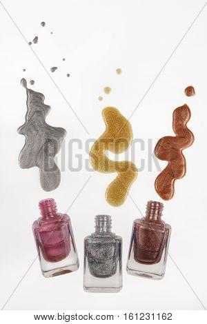 Three bottles with enamel on isolated background