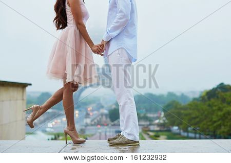 Unrecognizable Couple In Front Of The Eiffel Tower In Paris