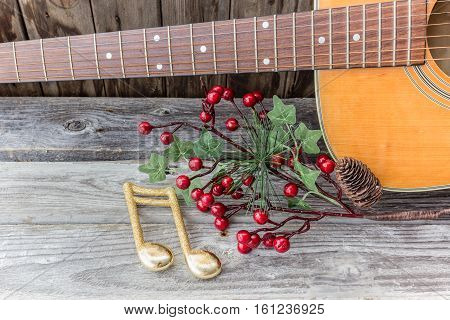 guitar with christmas decor on a wood background