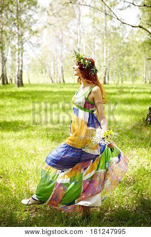 Yong woman enjoying non-urban summer walk in nature