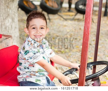 Cute little child boy in park on nature at summer. Use it for baby parenting or love conce