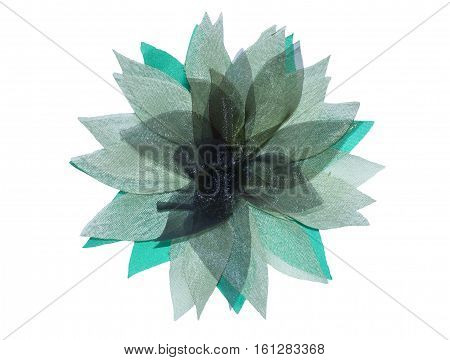 flower from organza of green color a hand-made article the hands on a white background