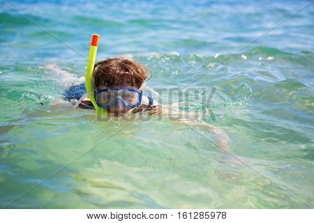 Woman snorkeling in turquoise tropical waters, vacation concept