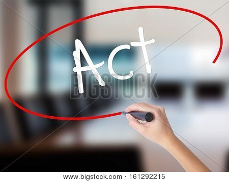 Woman Hand Writing Act With A Marker Over Transparent Board.