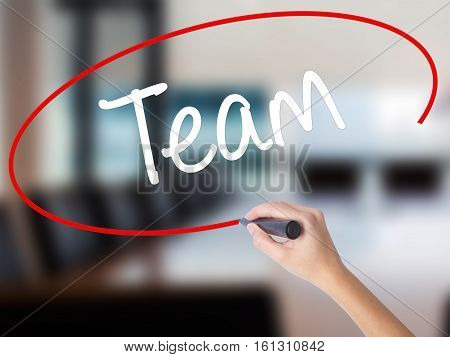 Woman Hand Writing Team With A Marker Over Transparent Board