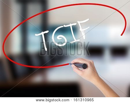 Woman Hand Writing Tgif With A Marker Over Transparent Board