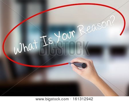 Woman Hand Writing What Is Your Reason? With A Marker Over Transparent Board