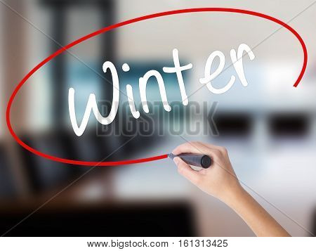 Woman Hand Writing Winter With A Marker Over Transparent Board