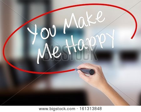 Woman Hand Writing You Make Me Happy With A Marker Over Transparent Board