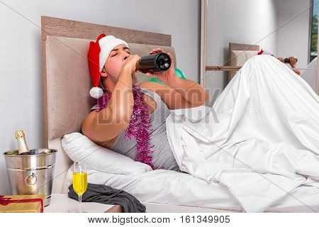 Young man having hangover after heavy partying