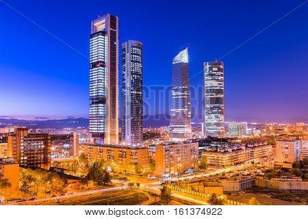 Madrid, Spain financial district skyline at twilight.
