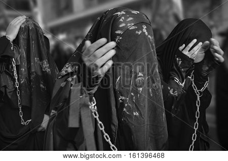 Istanbul Turkey - October 11 2016: Turkish Shia girls takes part in an Ashura parade in Istanbul's district of Kucukcekmece. Women and young girls muddy on top of them to accomodate the chronology of mourning.