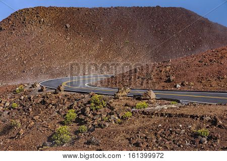 Winding Road at the summit of aHaleakala National Park near the volcanic crater Maui Hawaii USA