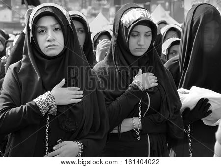 Istanbul Turkey - October 11 2016: Shia Muslim women mourn during Ashura. Turkish Shia Muslims mourning for Imam Hussain. Caferis take part in a mourning procession marking the day of Ashura in Istanbul's Kucukcekmece district Turkey on October 11 2016. T