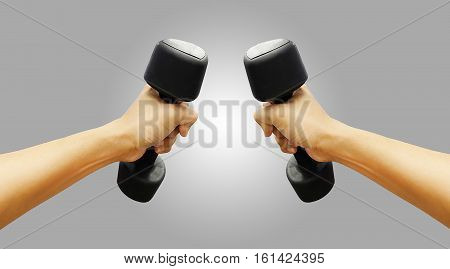 Hands Holding Dumbbells In Sport Club Or Gym And Fitness Room.