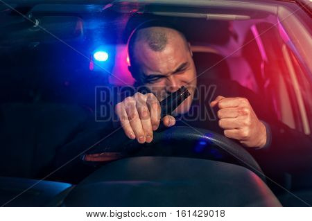 Angry Drunk Man Sitting In Car With Beer Bottle