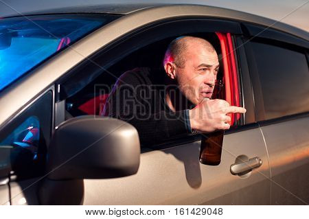 Drunk Driver With Beer Bottle Showing Fuck Gesture
