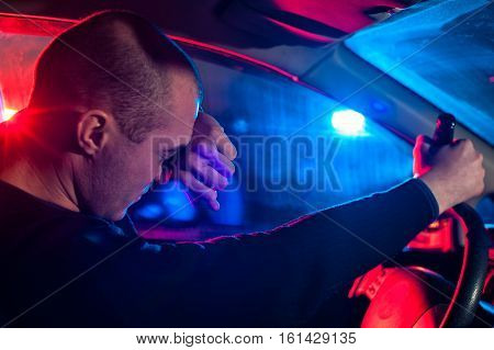 Young Driver Covering His Face From Police Light.