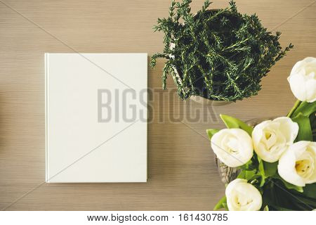 Blank Mock up Book cover on table with Plant white rose Flower
