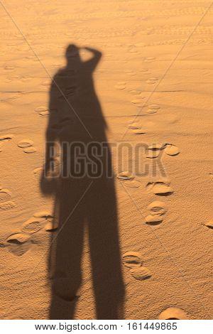 Shadow On The Ground In Desert