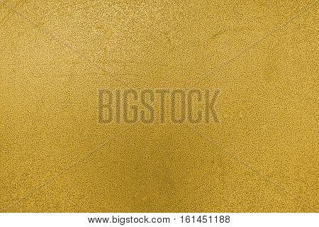 Metal, metal background, metal texture. Yellow metal texture, yellow metal background. Abstract metal background.