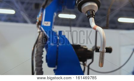 Automated robotic machine - mechanical arm for industrial welding, close up