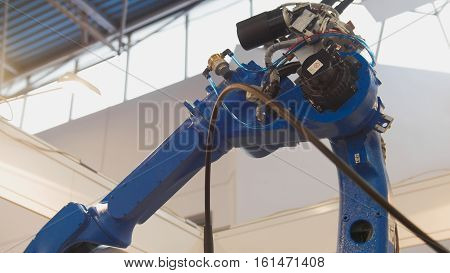 Automated machine - mechanical arm for industrial welding, close up