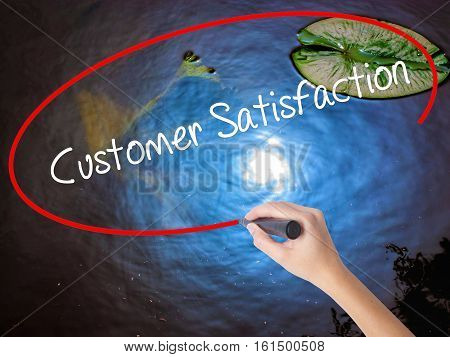 Woman Hand Writing Customer Satisfaction With Marker Over Transparent Board