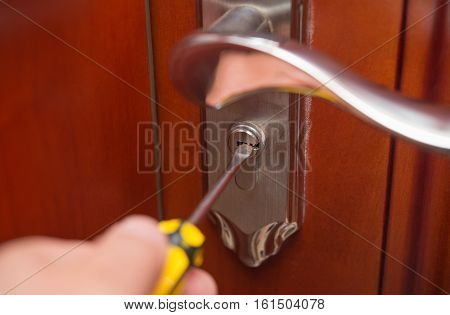 trying to open a door lock by screw driver