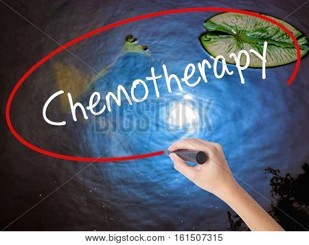 Woman Hand Writing Chemotherapy With Marker Over Transparent Board