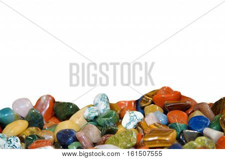Semi precious faceted stones on a white background. Colorful minerals. Natural gems. The geological formation close. Smooth beautiful stones.