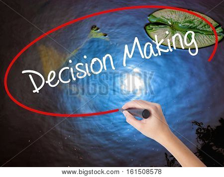 Woman Hand Writing Decision Making With Marker Over Transparent Board